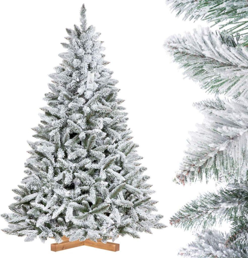 Árbol de Navidad artificial cubierto de nieve